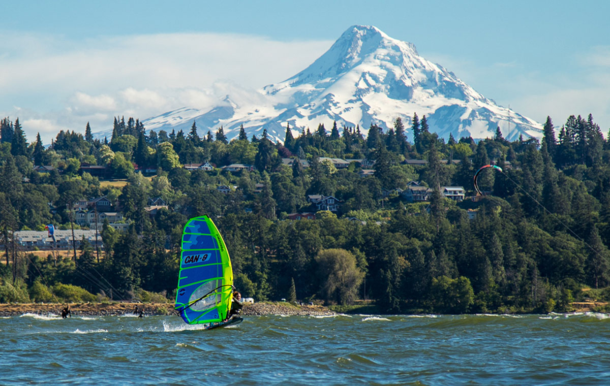 Phil Soltysiak windsurfing in front of Mount Hood on the Sailworks NX Slalom windsurfing race sail